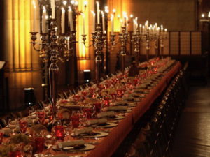 Long banquet tables with warm light at the Elisabethenkirche