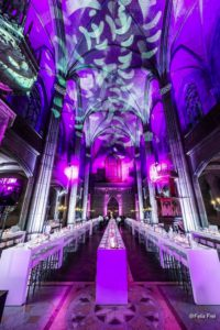 high seated dinner with white furniture and purple light