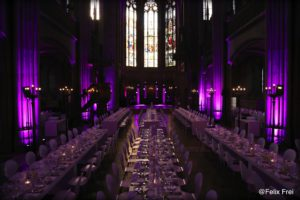long tables highlighted with purple light